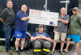 From left: Terry Cornett Kinsmen Club and firefighter, Bill Muirhead paramedic/MFR and society director, seated in a rehab chair Keigan Smith firefighter/squad member, Brett Carrigan retired firefighter/society co-chair and Mike Dean firefighter/society director and treasurer.