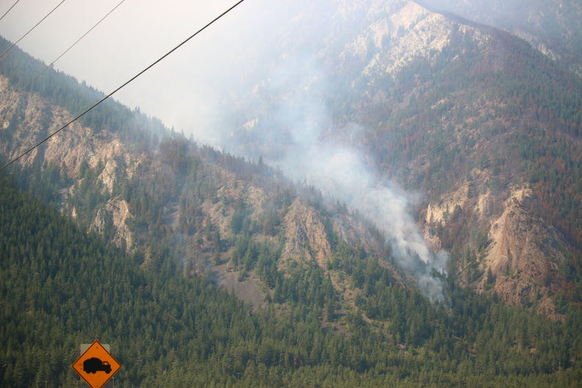 Kara McCurdy took this picture of one of the fires in the mountains on her way to Lytton, B.C., her first stop.