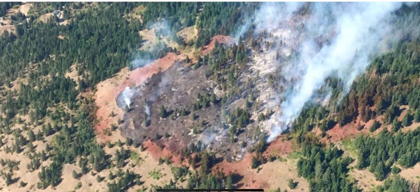 Kara McCurdy took this photo of one of the Vernon, B.C. fires while in an aircraft. The red is fire retardant, used to reduce fire spread.