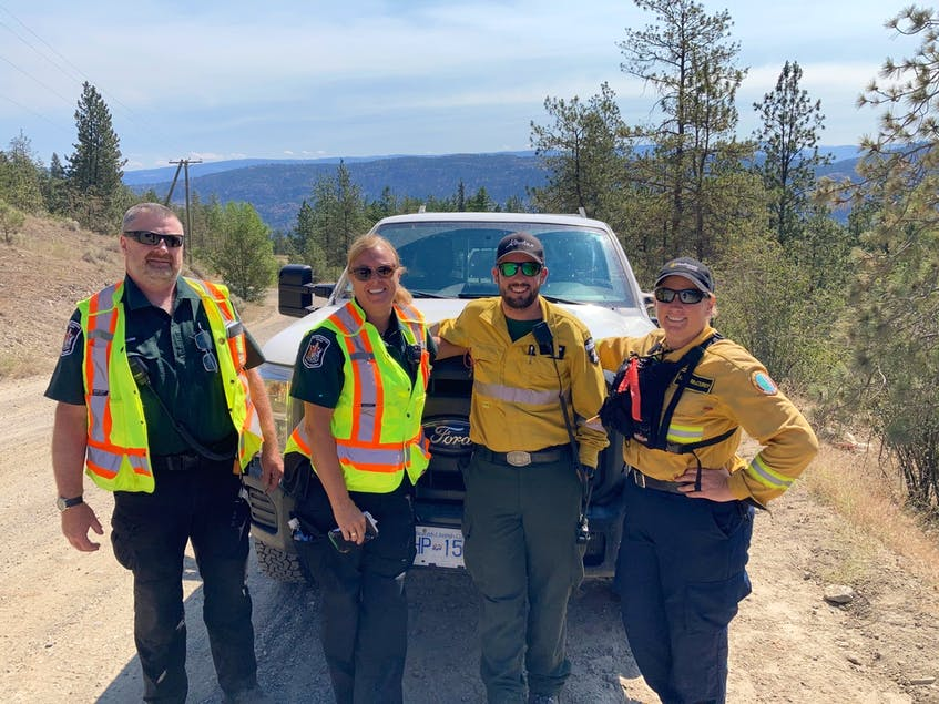 British Columbia officers Don Lemp and Tammy Jones, Dave Downes of Alberta and Kara McCurdy in Bear Creek Provincial Park near Kelowna, B.C., where a small park fire of 0.3 hectares was responded to quickly by the local fire crew but difficult to access.
