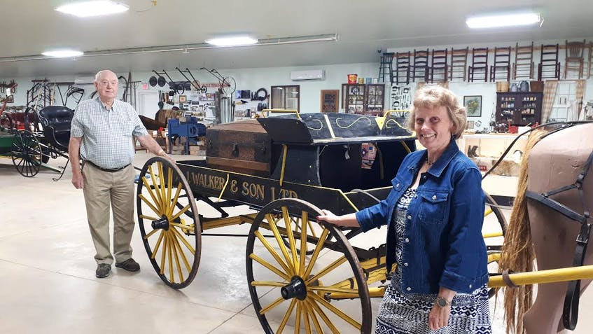 Dawn MacKay and Page Baird are two of the people who have been busy getting the Farm Equipment Museum ready to re-open. The museum will re-open to the public on Thursday, July 29. LYNN CURWIN PHOTO