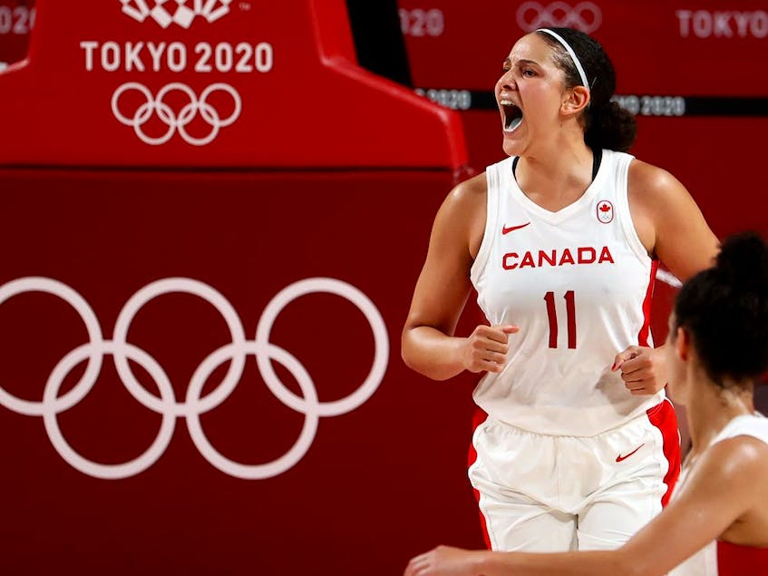 Natalie Achonwa of Canada celebrates after scoring a basket in Olympic action. - Brian  Snyder