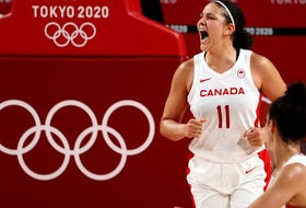 Natalie Achonwa of Canada celebrates after scoring a basket in Olympic action.