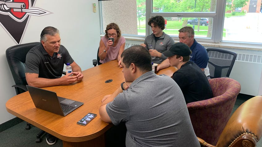 Tyler Peddle and his family sit down with the Drummondville Voltigeurs staff during a recent visit. - Drummondville Voltigeurs