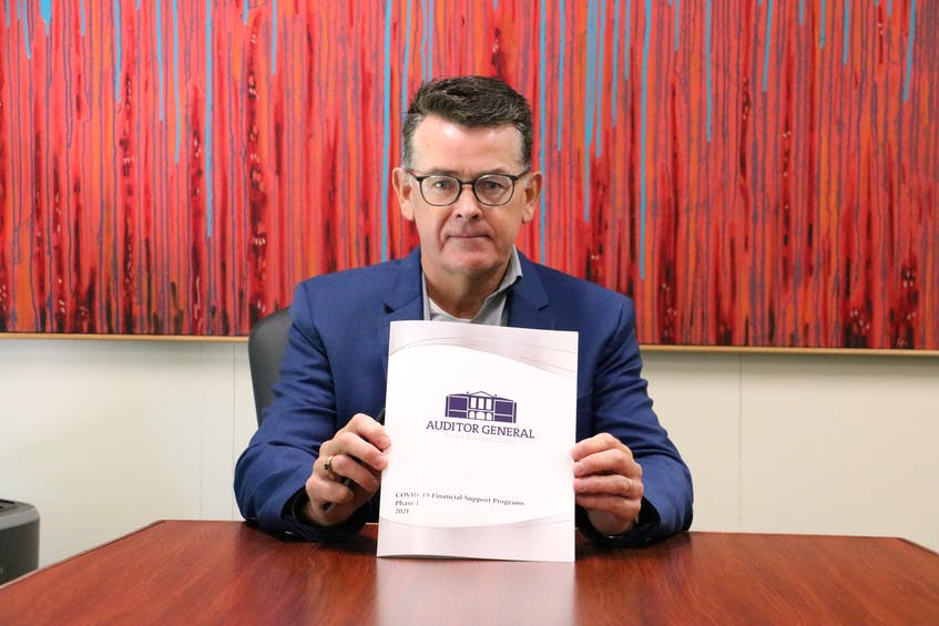 P.E.I. auditor general Darren Noonan holds a copy of an audit of P.E.I.'s initial COVID-19 relief programs. Subsequent audits will be completed of programs that were implemented after the summer of 2020. - Stu Neatby