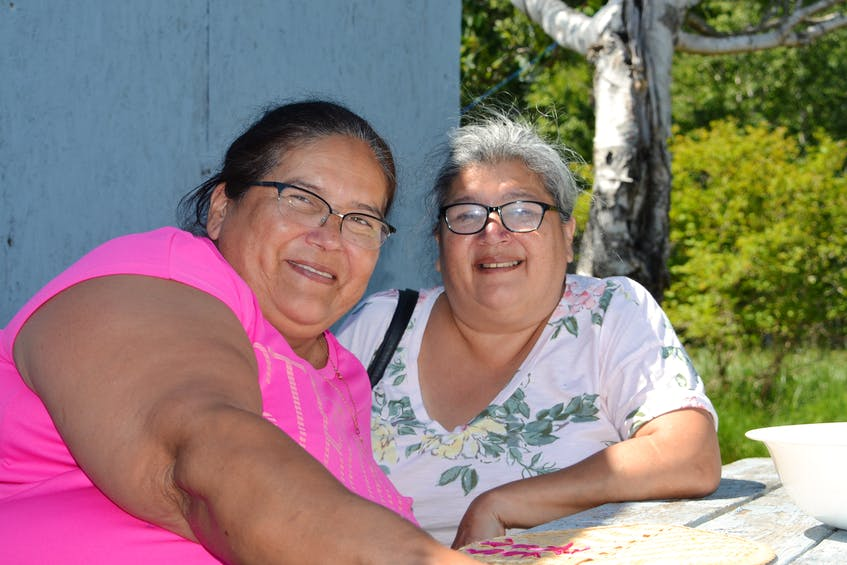 Sisters Anne Joe, left, and Frances Sylliboy, daughters of late Mi'kmaw poet Rita Joe, have been coming to the St. Anne's Mission since they were children. ARDELLE REYNOLDS/CAPE BRETON POST