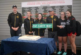 Pat Carty (third from right) was recently recognized for his contributions to track in Pictou County. The street leading to the Pioneer Coal Athletics Field is now named Pat Carty Way.