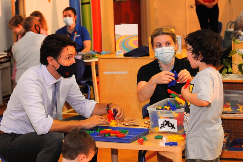 Above, Prime Minister Justin Trudeau speaks with CAN Daycare Centre kid uke Bambrick-McDonald, 4, as Early Childhood Educator (ECDE) Hilary Bartlett looks on at centre.  -Joe Gibbons/The Telegram