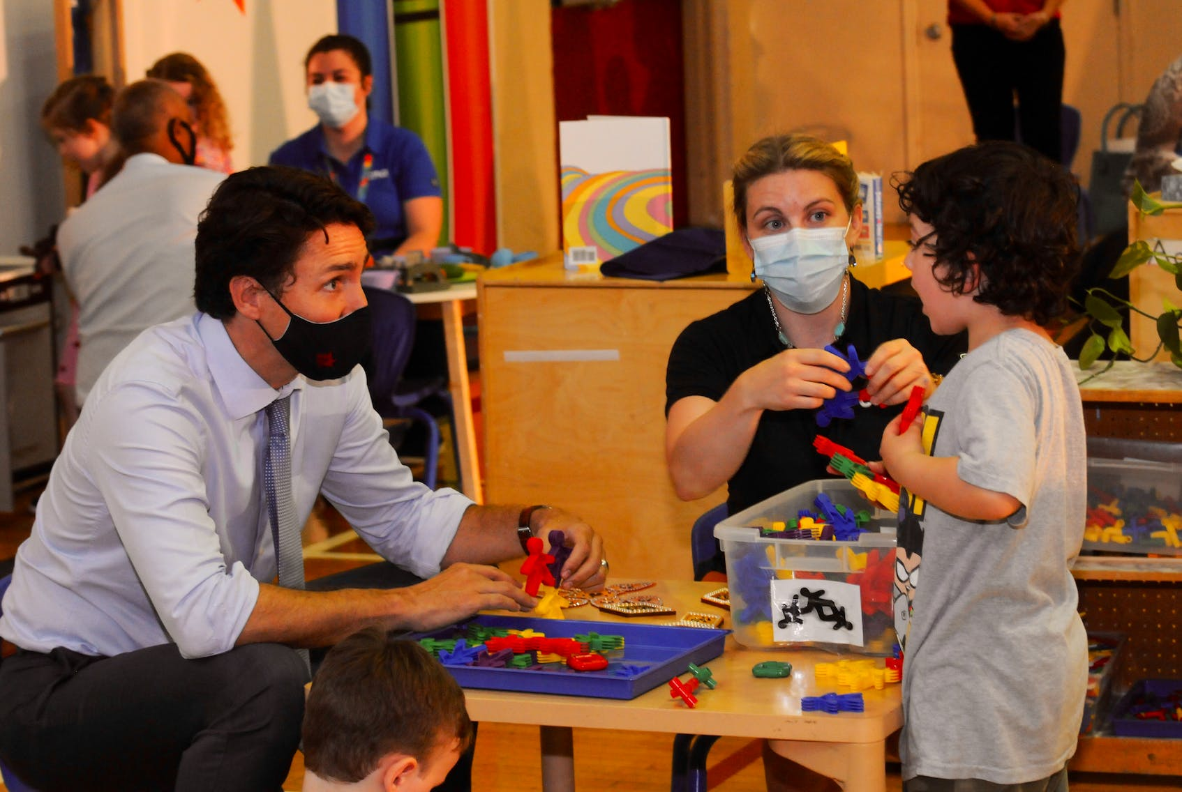 Prime Minister Justin Trudeau talks to a child in St. John's prior to a child care funding announcement, as early childhood educator Hilary Bartlett looks on. — SaltWire Network file photo
