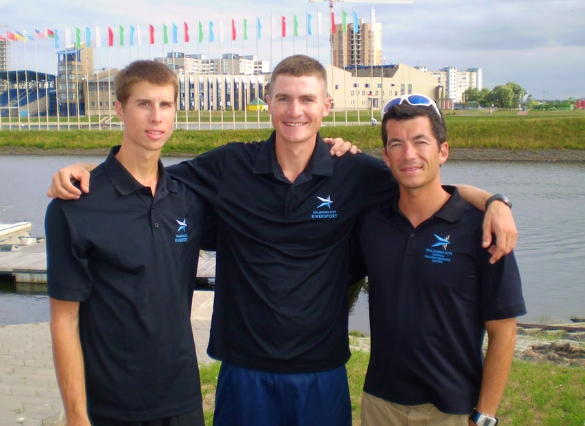 In this 2010 file photo, rowers Christian Klein (left) and Michael Kerrigan pose with coach Jeremy Ivey at the site of the world under-23 rowing championships in Brest, Belarus. Ivey was a coach at the U.S. Rowing's Oklahoma City National High Performance Center before joing the Canadian national rowing team. —  Oklahoma City National High Performance Center photo