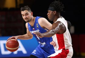 Canada's Luguentz Dort (right) defends against Czech Republic's Tomas  Satoransky during the first half of Olympic Qualifying semifinal action on Saturday at Memorial Arena in Victoria.