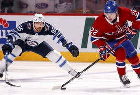 The Winnipeg Jets' Mathieu Perreault chases the Canadiens' Cole Caufield during Game 4 of second-round playoff series at the Bell Centre.