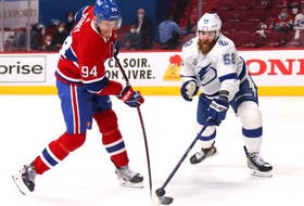 David Savard of the Tampa Bay Lightning defends against Corey Perry of the Montreal Canadiens during the second period of Game 3 of the 2021 NHL Stanley Cup finals at the Bell Centre on July 2, 2021, in Montreal.