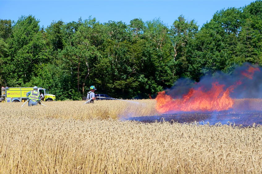 Firefighters from Waterville, Canning, New Minas and Port Williams assisted Kentville firefighters with their efforts to contain and extinguish a spreading agricultural fire. - Adrian Johnstone