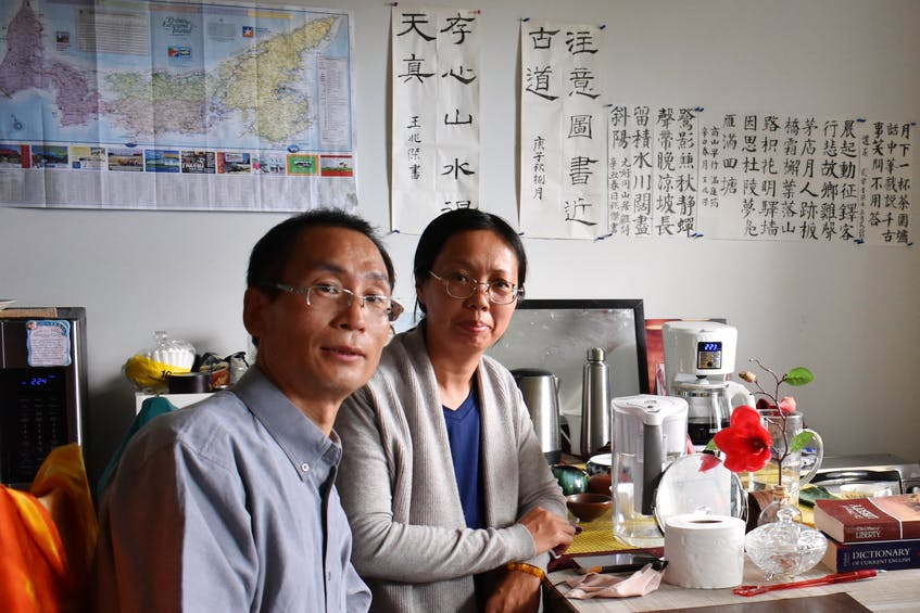 Jerry Wang and his wife, Julie Zhu, sit at their kitchen table in their apartment in Charlottetown. - Michael Robar