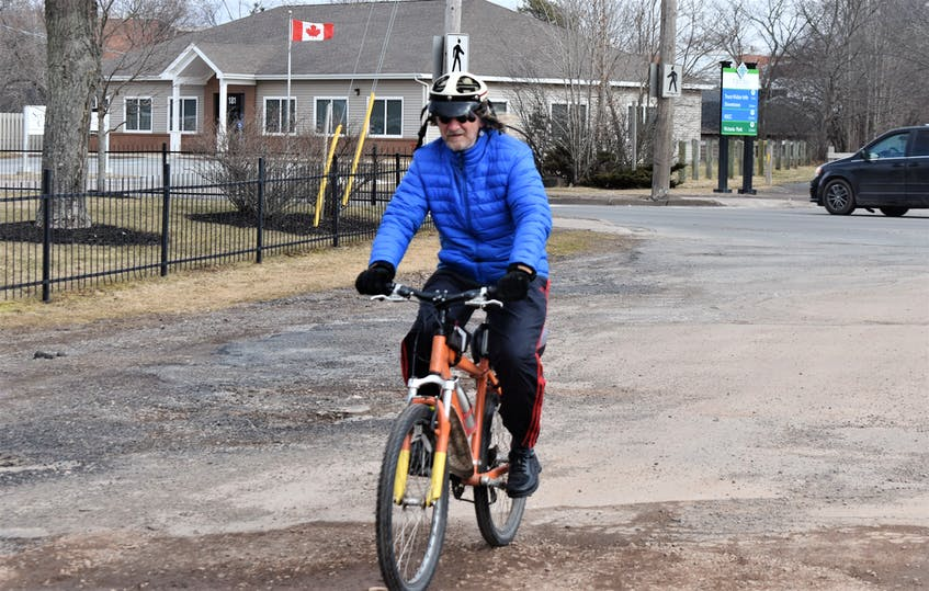 Something as simple as riding your bike while following municipal bylaws and provincial laws, as Frank Graham was doing this spring on the Cobequid Trail, could earn a person a Positive Ticket. - File  photo