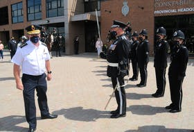 Royal Newfoundland Constabulary Chief Joe Boland (left) is greeted by an RNC honour guard and its commander, Insp. Alex Brennan (right), on July 30 after he walked out of RNC Provincial Headquarters at Fort Townshend on Parade Street in St. John's. Boland retired Friday after 38 years as a member of the RNC, and upon his departure was greeted by members of the RNC mounted unit, police service dog units, the honour guard, friends, and various other RNC members and civilian staff. Joe Gibbons • The Telegram