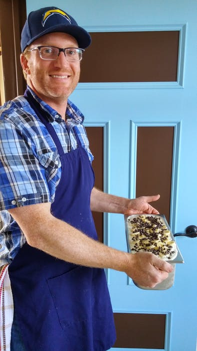 Adam Rochacewich, co-owner of Sweet Rock Ice Cream in Trinity, N.L., is seen here with one of the popular ice cream maker's many homemade flavours, the Spotted Monkey, which is essentially a banana chocolate chip mix.