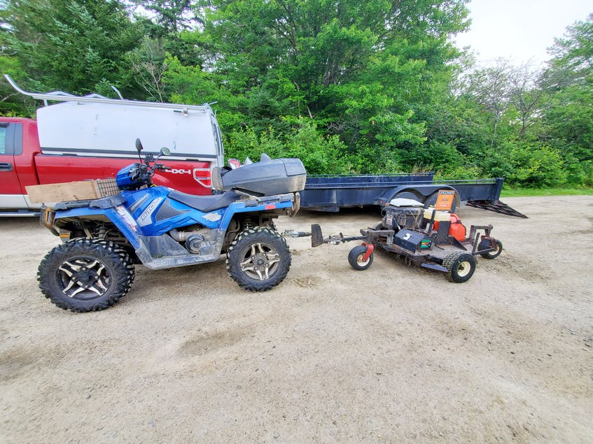 Darryl Crosby's quad hooked up to a groomer. The Yarmouth, N.S., man is part of a group of volunteers who help with the upkeep on the railbed rails in his region of Nova Scotia.