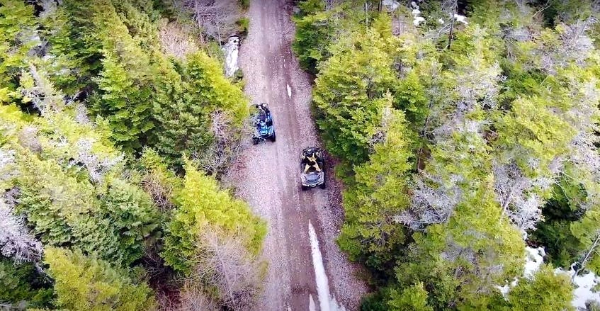 An overhead view of quad riders on the Newfoundland T'railway. The T'railway allows people to ride from coast-to-coast in Newfoundland.