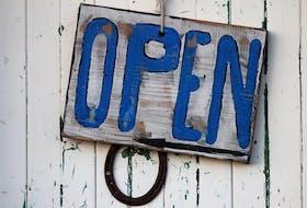 Beach-themed open sign.