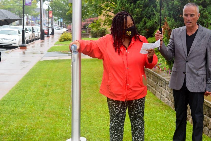 Tracey Dorrington-Skinner pouring water for libation.