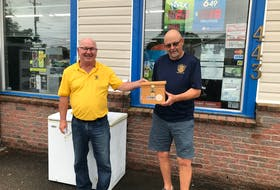 Bryson Crowell, left, and Jim Balcom are shown with one of the boxes where participants place toonies to enter Middleton Rotary Club's weekly Goldmine 50/50 Draw. The boxes are located in 20 vendor locations from Aylesford to Annapolis. Contributed