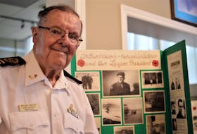 A number of Art Hiscock's Korean War photos are displayed on a board featured at a Korean War remembrance ceremony held on Wednesday, July 28 at the Summerside Legion. Hiscock is the Summerside Legion's oldest Korean War veteran.