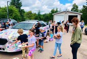BOLD summer campers enjoyed a field trip to Baddeck RCMP station where they painted on police cars, had barbeque and learned about inclusion from Cape Breton Youth Project 2SLGBTQ+ educators. CONTRIBUTED
