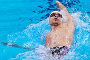 Russia's Evgeny Rylov competes in the final of the men's 200m backstroke swimming event during the Tokyo 2020 Olympic Games.