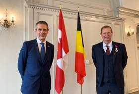 Ambassador Johan Varkemmen and Honorary Consul Patrick Philips were fascinated by the courage and tenacity of early Belgian immigrants.