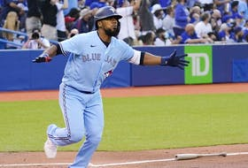 Toronto Blue Jays left fielder Teoscar Hernandez (37) reacts after hitting a solo homerun against the Kansas City Royals during the second inning at Rogers Centre.