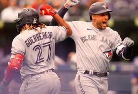 Blue Jays' George Springer (right) celebrates a home run with teammate Vladimir Guerrero Jr. (27) in the first inning  against the Royals at Rogers Centre in Toronto, Saturday, July 31, 2021.