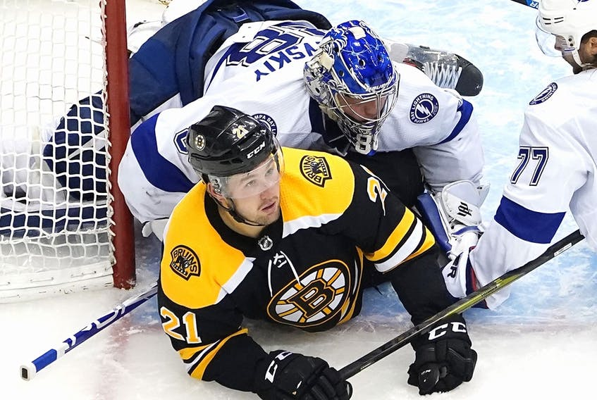 Andrei Vasilevskiy of the Tampa Bay Lightning lands on top of Nick Ritchie of the Boston at Scotiabank Arena on August 5, 2020 in Toronto.