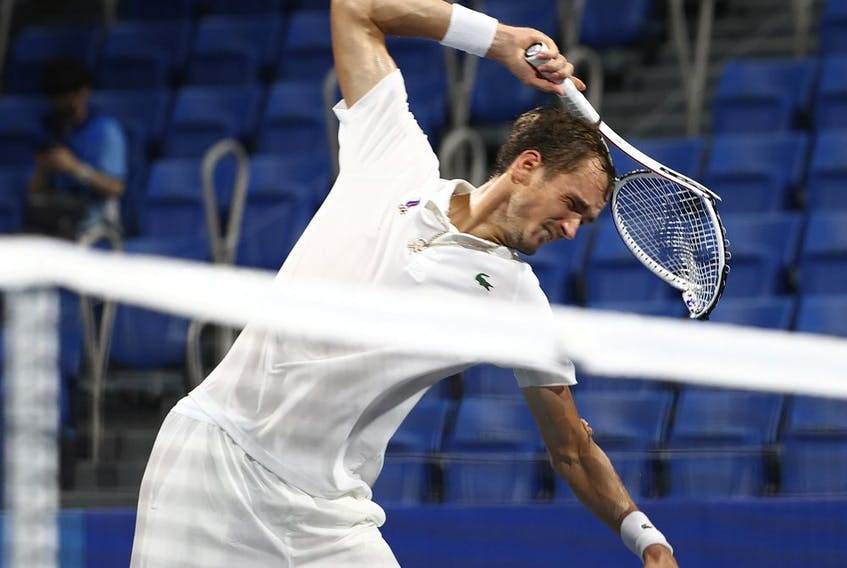 Daniil Medvedev of the Russian Olympic Committee breaks his racket after losing his quarter-final match against Pablo Carreno of Spain.