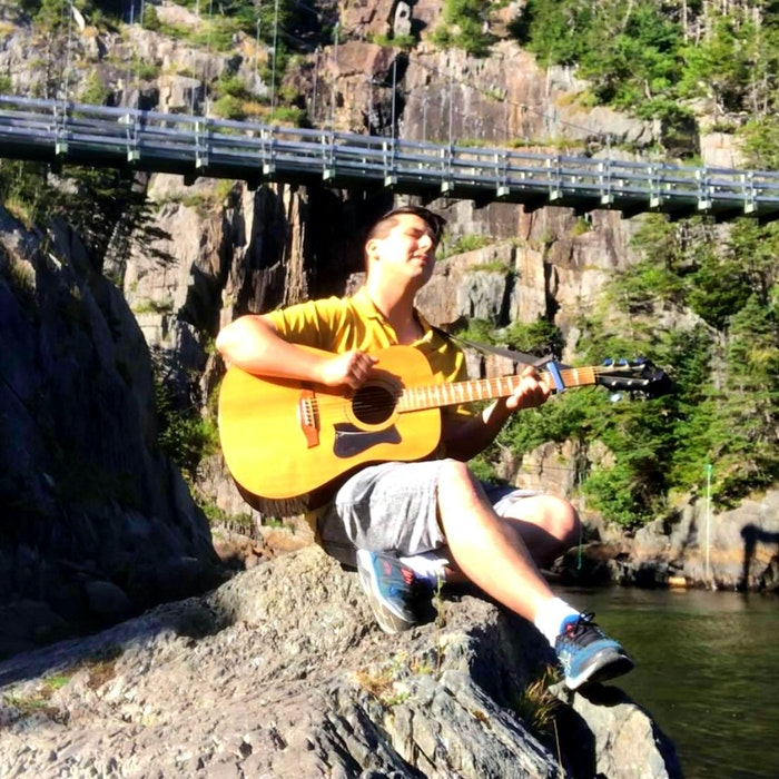 For Brian Pottle, relaxation comes in playing his guitar, preferably near a body of water. — Facebook