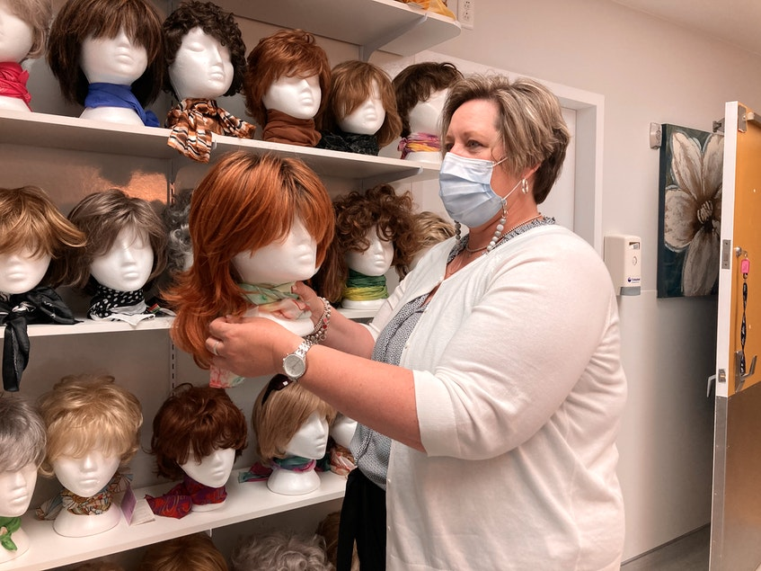 Terri Dennis, executive director with the Northside-Harbourview Hospital Foundation, holds one of the wigs available through the wig bank at Northside General Hospital in North Sydney. Dennis says the wig bank was opened in 2015 when the need was determined. Lynn Gilbert/Nova Scotia Health - Contributed