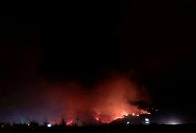 Flames rise as a wildfire burns on a hill in Kamloops, British Columbia, Canada on July 1, 2021, in this picture obtained from social media. Picture taken July 1, 2021.