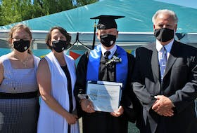 With his high school graduation diploma for adults in hand, Charles Trenholm says he can now finish anything he sets his mind to. Pictured congratulating the 71-year-old on his accomplishment were the school's teachers, Tatyana Currie, Joanne MacGillivray, and Greg Mackin.