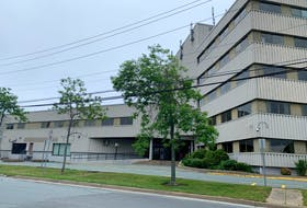 An empty parking lot is seen at Dartmouth provincial court after it closed in relation to a threats call on Tuesday, July 6, 2021, Halifax Regional Police said.