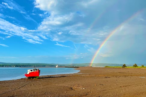 """One evening last week, following a wonderful, much-needed rain shower, Sandy Graham took the dog for a walk on the beach off Lighthouse Road in Parrsboro. They were greeted by this stunning scene, complete with a double rainbow. Sandy says: """"two minutes later, it was gone. Count our blessings while we may."""""""