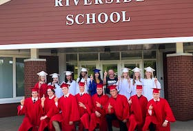 It wasn't teachers or principals former students of Riverside School would come to see when they were graduating from high school, it was Ken LeBlanc pictured here in the centre, not in the cap and gown, with graduates in 2018. The retired ground supervisor and after-school program co-ordinator retired in the fall of 2020 because of his health and died on July 4, 2021. CONTRIBUTED