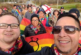 Geordy Marshall, left, co-founder of Pride Eskasoni, and John R. Sylliboy, right, of the Wabanaki Two-Spirit Alliance, leading the first Pride parade in Eskasoni First Nation in 2016. Eskasoni was the first Mi'kmaw community to hold a Pride event, and is now helping others to start their own festivals. CONTRIBUTED