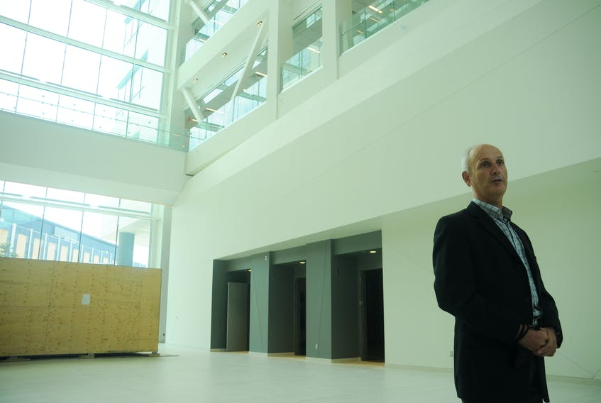 Mark Abrahams, provost and vice-president (academic) pro tempore of Memorial University, speaks in the main atrium of the new core science building.