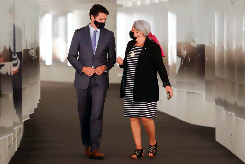 Prime Minister Justin Trudeau walks to a news conference with Mary Simon to announce her as the next Governor General of Canada in Gatineau, Quebec, Canada July 6, 2021.