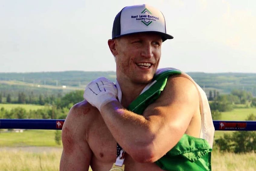 Cape Breton product Mark MacKinnon claimed the World Boxing Council Canadian Cruiserweight Muay Thai Championship, defeating Tim Lo by unanimous decision at Grey Eagle Resort and Casino in Calgary on Saturday.