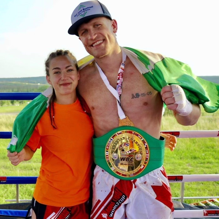 Mark MacKinnon, originally of Sydney, with his girlfriend Hope Quinn after winning the World Boxing Council Canadian Cruiserweight Muay Thai Championship in Calgary on Saturday. MacKinnon and Quinn, who train together, both fought successfully on Saturday's card. CONTRIBUTED