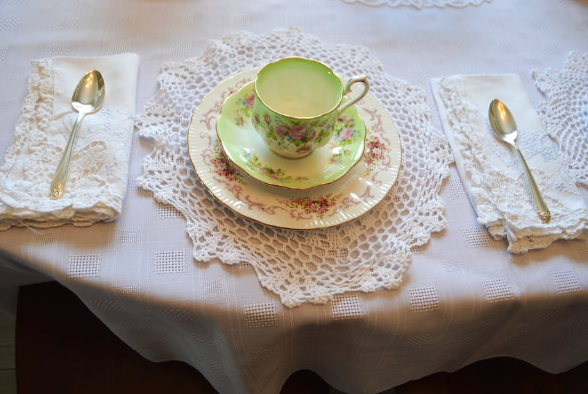 A Royal Albert tea cup among the pieces of vintage china on a table Donna Copper has at her home in Whitney Pier for her new business, 'Elegant Afternoon Tea.' Cooper has had a love of china since a child. Sharon Montgomery-Dupe/Cape Breton Post