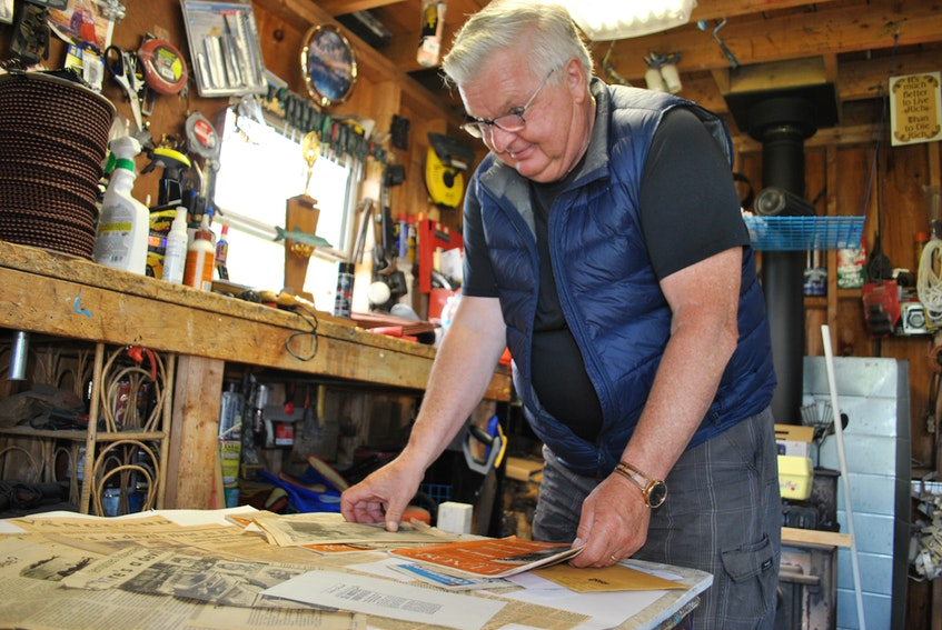 South Side fisherman Rodney Ross looks through his collection of memorabilia about the sea creature he and four other fishermen including his father Keith seen between July 5 and 9, 1976, on the Pollock Shoal off Cape Sable Island's southern coast.  KATHY JOHNSON