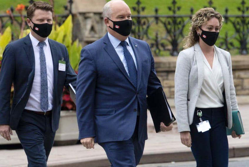 Conservative Leader Erin O'Toole walks to a caucus meeting in Ottawa with his chief of staff Tausha Michaud and campaign manager Fred DeLorey in Ottawa on Sept. 9, 2020.